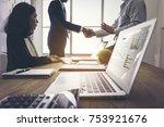 business handshake of two men.... | Shutterstock . vector #753921676