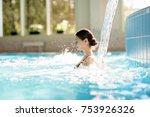 serene girl enjoying stream of... | Shutterstock . vector #753926326