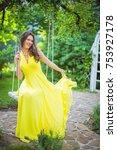 beautiful girl in yellow dress  ... | Shutterstock . vector #753927178