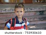 child sitting outside school ...   Shutterstock . vector #753930610