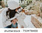 Stock photo  pretty young woman playing with her adorable dog jack rusell in a park surrounded by cactus and a 753978400