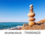 colored stones balance on a... | Shutterstock . vector #754004620
