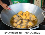 Small photo of chef cooking deep-fried shrimp in the big pan to chinese banquet food preparation. fat from trans-fat concept. disease from cholesterol and Trans-fatty concept