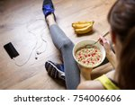 young girl eating a oatmeal... | Shutterstock . vector #754006606