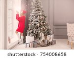 happy winter woman blowing snow.... | Shutterstock . vector #754008658