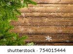 wood background with fir branch ... | Shutterstock . vector #754015444