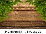 wood background with fir branch | Shutterstock . vector #754016128