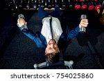businessman doing exercises...   Shutterstock . vector #754025860