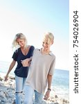 mum and teenager son walking... | Shutterstock . vector #754026904