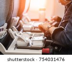 woman passengers eats lunch in... | Shutterstock . vector #754031476
