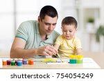 father and child paint together.... | Shutterstock . vector #754054249