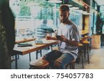 young handsome hipster guy... | Shutterstock . vector #754057783