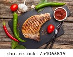 grilled pork steak on the bone... | Shutterstock . vector #754066819