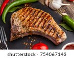 grilled pork steak on the bone... | Shutterstock . vector #754067143