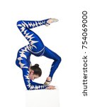 Small photo of Acrobat does gymnastics, isolated image on a white background. A young circus artist in a blue suit , performs acrobatic elements.