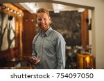 young businessman holding... | Shutterstock . vector #754097050