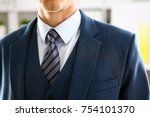 Male arm in blue suit set tie...