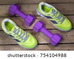 sports sneakers and dumbbells...   Shutterstock . vector #754104988