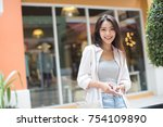 asia woman walking and using a... | Shutterstock . vector #754109890