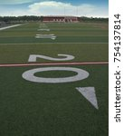 Small photo of 20 yard line hash mark on the football field.