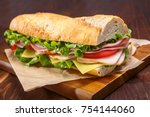 large subway baguette sandwich... | Shutterstock . vector #754144060