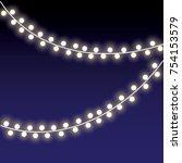 yellow christmas lights on dark ... | Shutterstock .eps vector #754153579