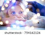 lonely sad girl lying on bed in ... | Shutterstock . vector #754162126