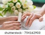close up of the hands of a... | Shutterstock . vector #754162903