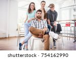 portrait of four co workers... | Shutterstock . vector #754162990