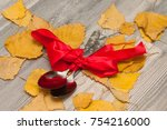 spoons are wrapped in a red... | Shutterstock . vector #754216000