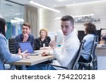 group of a young business... | Shutterstock . vector #754220218