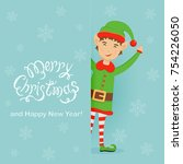 happy elf standing behind a... | Shutterstock .eps vector #754226050