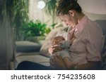 young beautiful mother ... | Shutterstock . vector #754235608