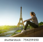 girl looking at the eiffel... | Shutterstock . vector #754259350