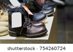 shoes for sale in a shop... | Shutterstock . vector #754260724