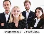 Small photo of Group of smiling people stand in office looking in camera portrait. White collar power mediation solution project creative advisor participation profession train bank lawyer client visit concept