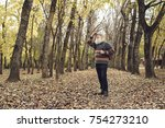 cheerful old man enjoying walk... | Shutterstock . vector #754273210