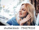 blond woman in blue dress have... | Shutterstock . vector #754279210