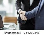 handshake of business partners... | Shutterstock . vector #754280548