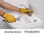 plumber installs a new faucet... | Shutterstock . vector #754283890