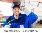 welder with welding device in... | Shutterstock . vector #754290676