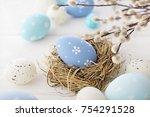 easter eggs and flowers   Shutterstock . vector #754291528