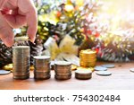 coins saving growth to profit...   Shutterstock . vector #754302484