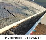 roof shingles and gutter with... | Shutterstock . vector #754302859