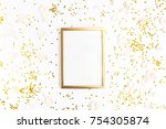 Stock photo christmas frame mock up with space for text golden confetti and rose petals on white background 754305874
