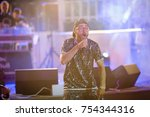 "Small photo of Odessa, Ukraine June 8, 2014: Bono beach club. Famous Russian Artists L""One and MOT performs new club show songs from stage during concert at nightclub. Artist on club stage during night party"