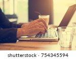 close up senior male hand using ... | Shutterstock . vector #754345594