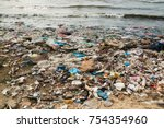 polluted beach in a fishing... | Shutterstock . vector #754354960