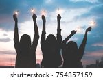 silhouette happy group of asia... | Shutterstock . vector #754357159