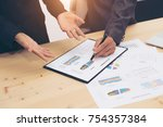 close up of business meeting... | Shutterstock . vector #754357384